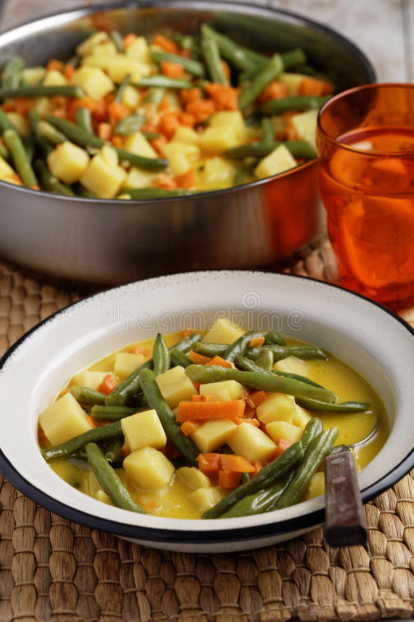 Haricots verts au curry photographie stock