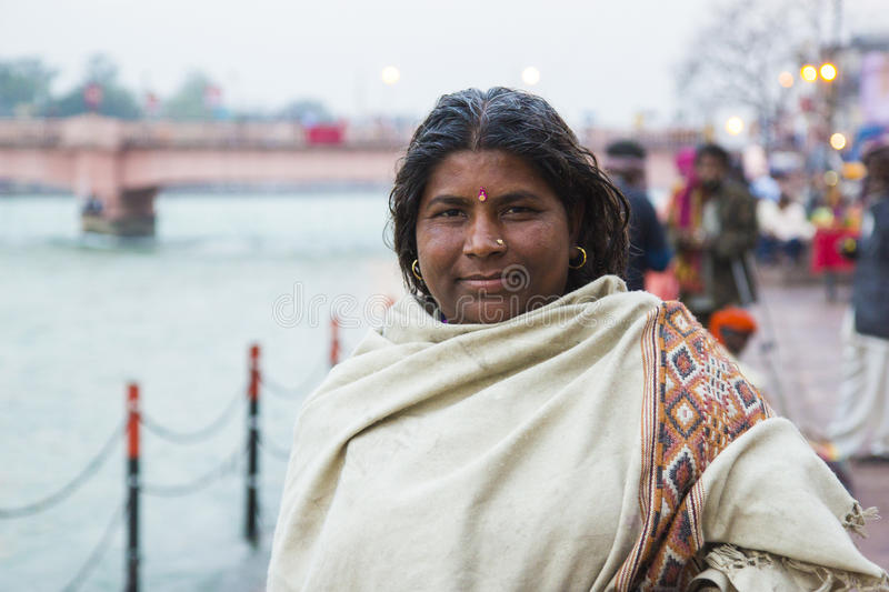 HARIDWAR, INDIA - MARCH 23, 2014: indian woman on the bank of Ganga river stock image