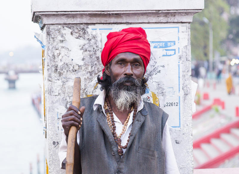 HARIDWAR, INDIA - MARCH 23, 2014: Sadhu portrait on the bridge of Ganga river. stock photography