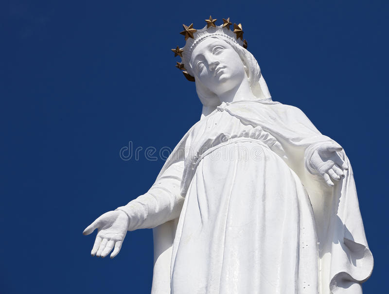 Harissa, Our Lady of Lebanon statue against a blue sky royalty free stock photo