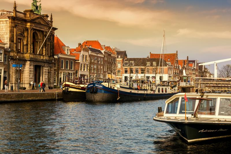 Spaarne river with boats and houses at sunset in Haarlem, Netherlands stock photo