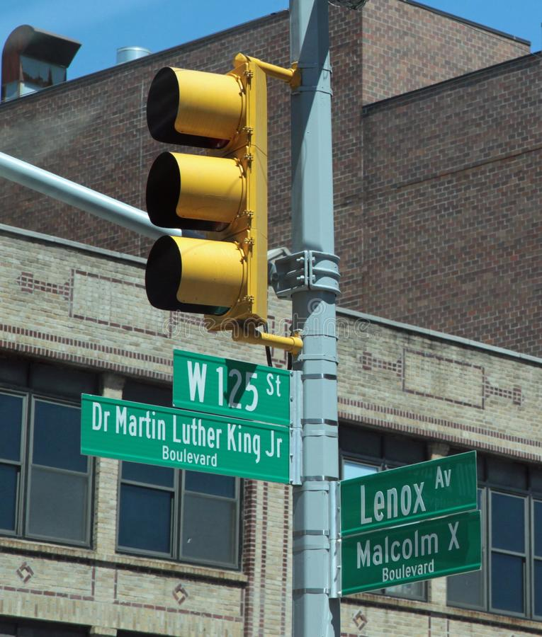 Harlem Street Signs, New York City. Harlem, NYC, street sign showing W. 125th St. and Dr. Martin Luther King Jr, and Malcolm X Blvds stock photos