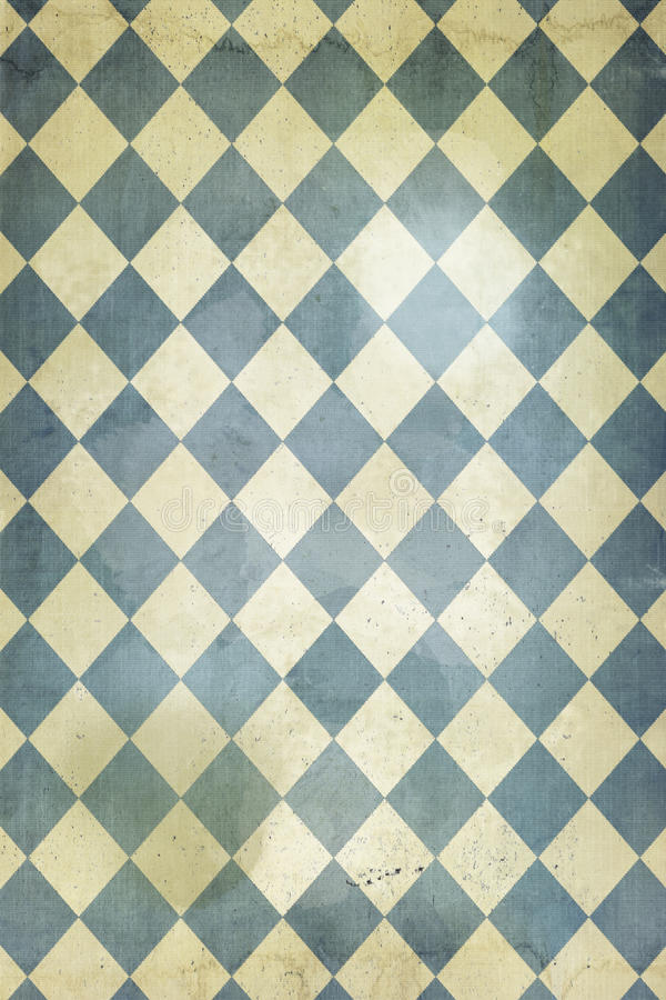 Harlequin wallpaper. Faded and distrssed wallpaper with a harlequin pattern royalty free stock photo