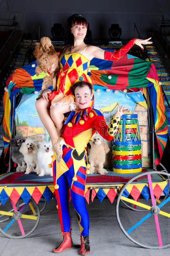 Harlequing lifting up Colombina and poodle royalty free stock photo