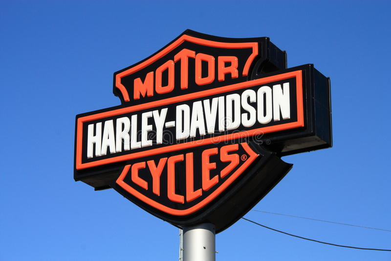Harley-Davidson. Harley Davidson logo sign on blue sky background. Harley-Davidson often abbreviated H-D or Harley, is an American motorcycle manufacturer royalty free stock image