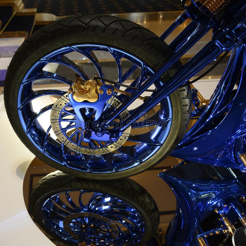 Harley-Davidson Blue Edition Front Wheel with Tire and Disc brake system in blue and gold royalty free stock photo
