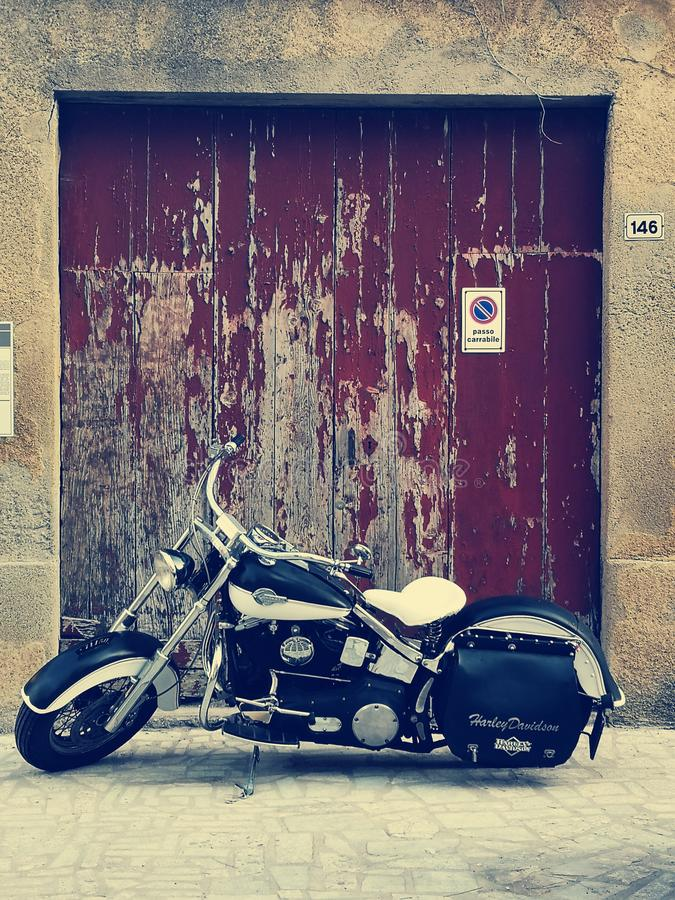 Harley Davidson classic motorcycle. Harley Davidson motorcycle in front of old weathered garage door royalty free stock photos