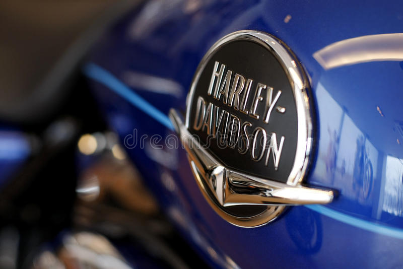 Harley Davidson logo. Is displayed on a motorcycle in a new Harley show room royalty free stock image
