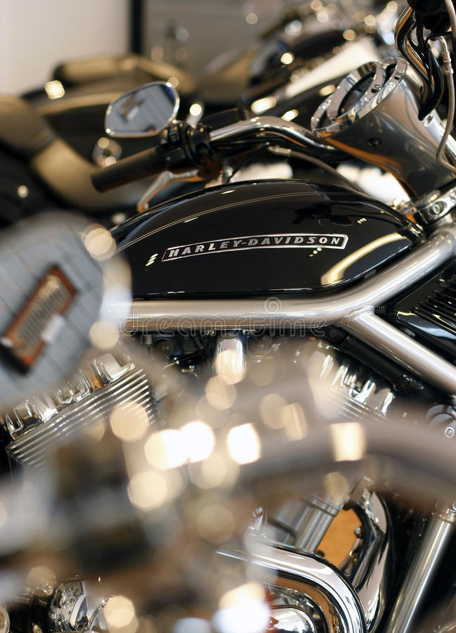 Harley Davidson logo. Is displayed on a motorcycle in a new Harley show room royalty free stock photos