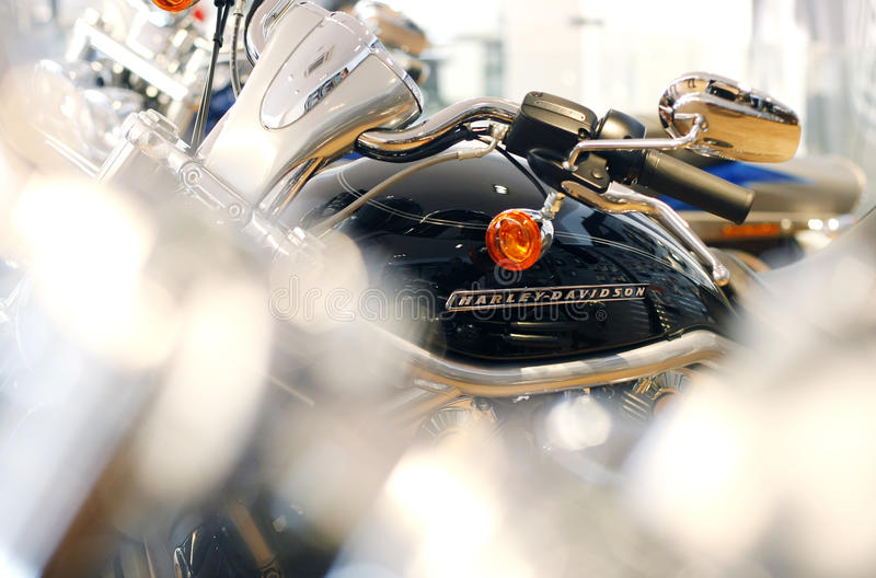 Harley Davidson logo. Is displayed on a motorcycle in a new Harley show room stock photos