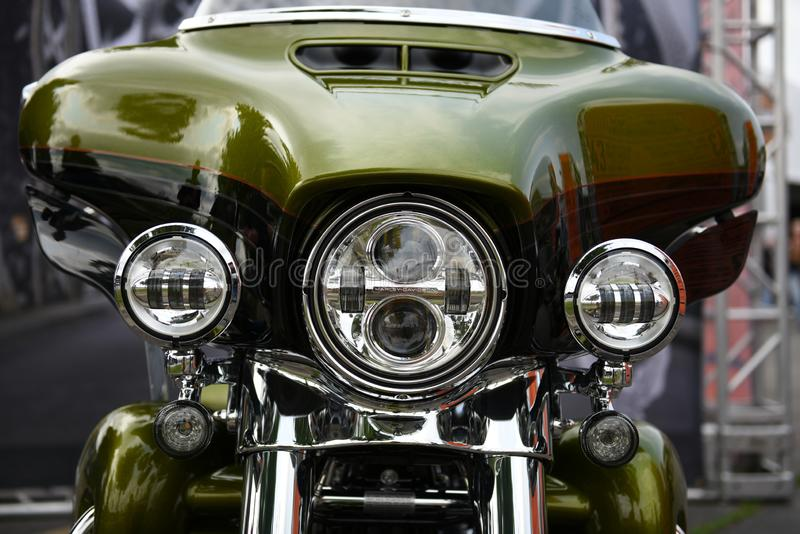 Harley Davidson motorcycle front end view, green color. Chrome and headlights in Sturgis, South Dakota, USA royalty free stock photography
