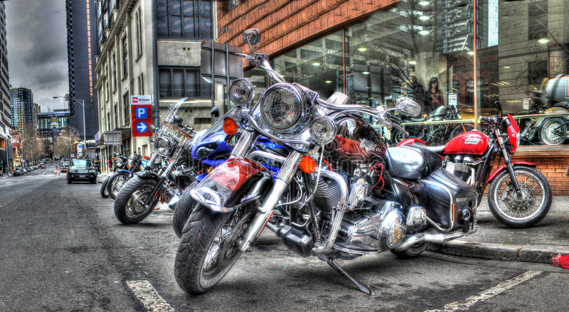 Harley Davidson motorcycles. Custom painted Harley Davidson motorcycles parked on street in Melbourne Australia royalty free stock photography