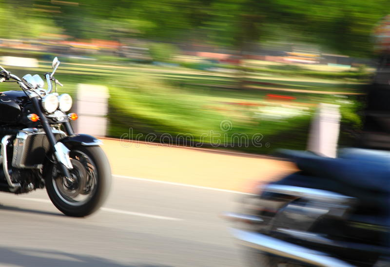 Harley Davidson motorcycles. Are racing on the road stock photography