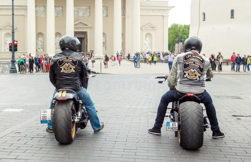 Harley Davidson riders. Vilnius, Lithuania - May 21, 2016: Two riders sitting on Harley Davidson bikes and waiting for green light on the street in Vilnius stock photos