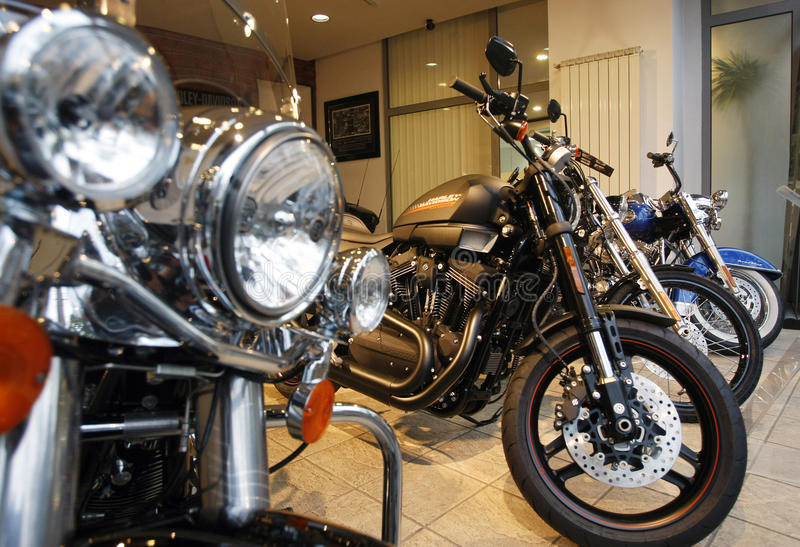 Harley Davidson Show Room. Harley Davidson motorcycles are displayed in a new Harley show room royalty free stock image