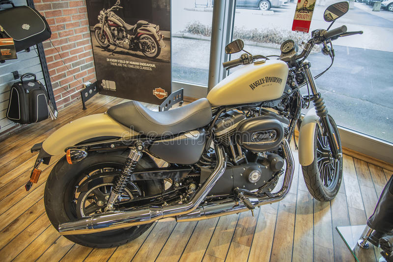 2014 Harley-Davidson, Sportster Iron. Model: XL883N. Photo is shot in an authorized Harley-Davidson shop in Sarpsborg, Norway one day in March 2014. Telephone royalty free stock image