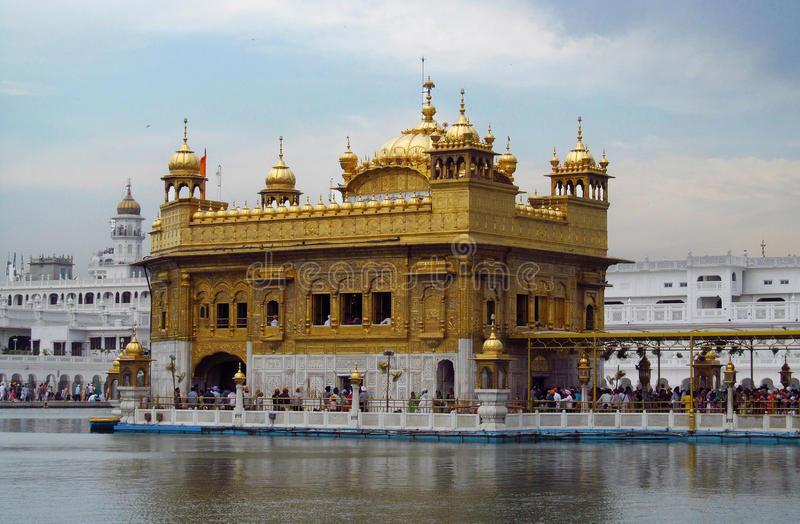 Harmandir Sahib, Amritsar. People in a line to a holy book Harmandir Sahib - Golden Temple, in Amritsar, India. The holy place of worship of the Sikhs, famous stock image