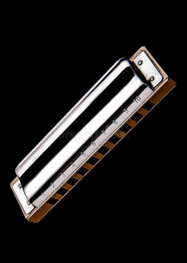 Harmonica Isolated på svart bakgrund arkivfoto