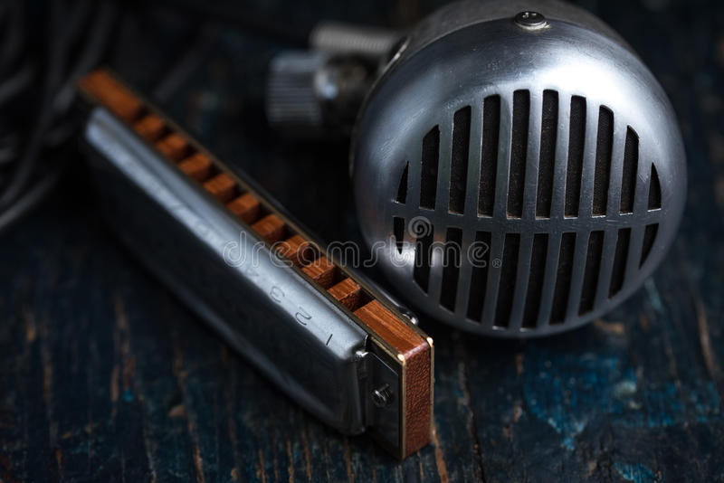 Harmonica and Microphone stock images