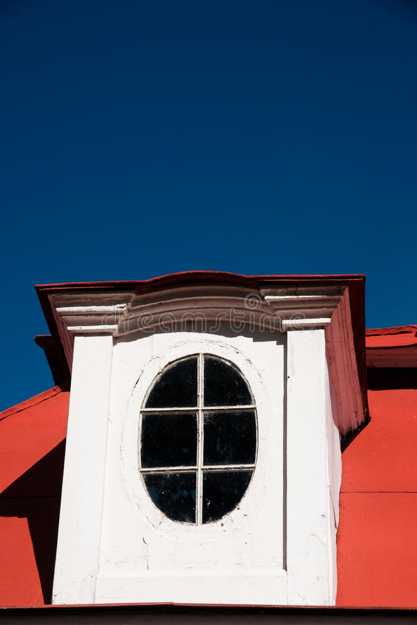 Harmony of colors. Fragment housetop. attic, garret. Deep blue sky. lucarne royalty free stock image