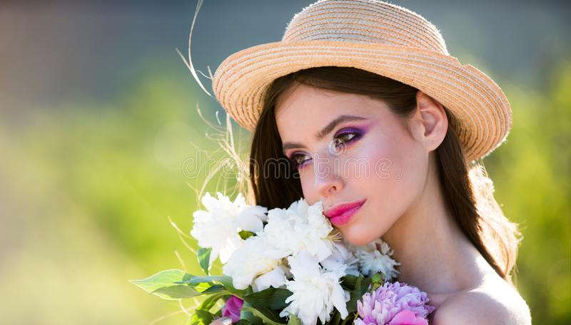 Harmony concept. face and skincare. Travel in summer. Summer girl with long hair. flowers. Woman with fashion makeup. Spring woman. Springtime and vacation royalty free stock photography