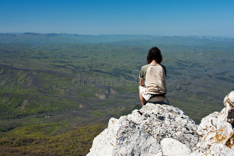 In harmony with nature. Man meditating in the mountains royalty free stock photography