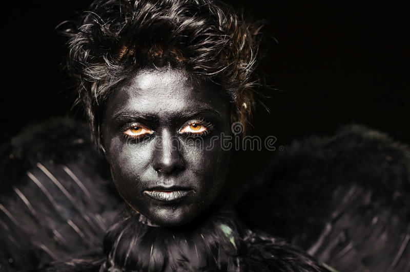 Harpy - mystical creature. Glare look of harpy - mystical creature, isolated on black stock photos