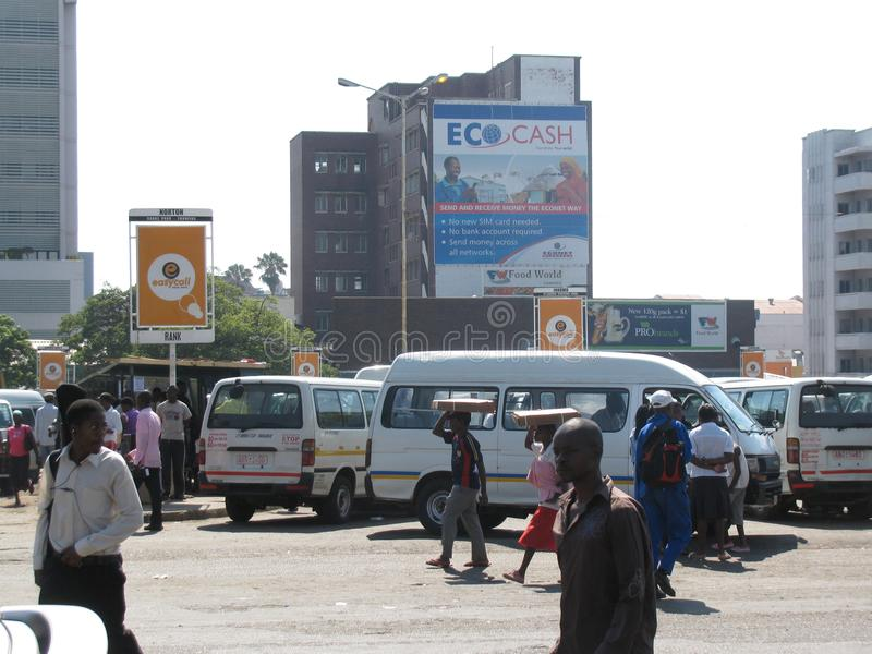 Scene at a taxi rank in Africa. Harrare,Zimbabwe,March 13 2015.Commuter taxi minibusers parked at a taxi rank in thed central business of the city stock image