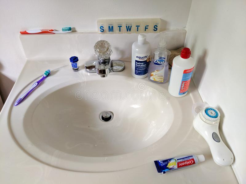 Harrisburg, PA - August 31, 2019 -Clean bathroom vanity with personal hygiene items royalty free stock photography