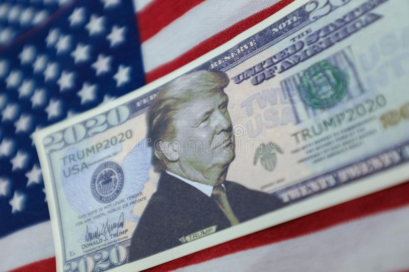 Harrisburg, PA - September 26, 2019 : Donald Trump 2020 Re-Election Presidential Dollar Bill against a United States of America. Flag royalty free stock photo