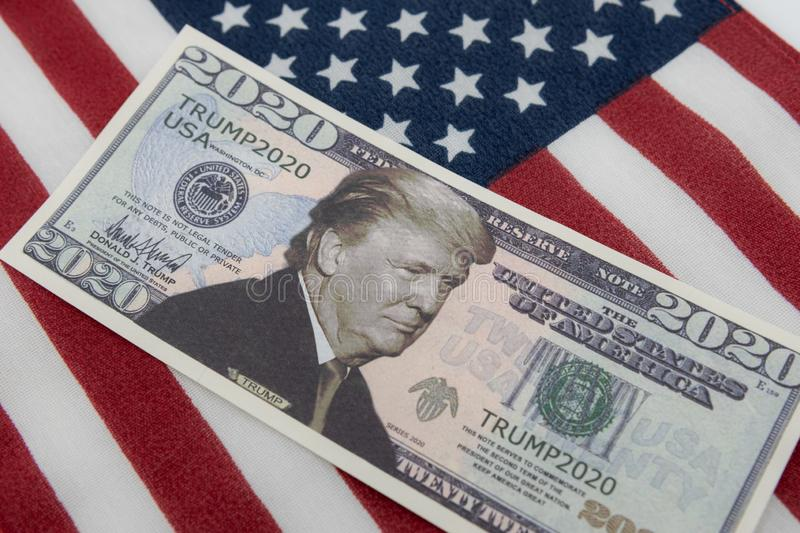 Harrisburg, PA - September 26, 2019 : Donald Trump 2020 Re-Election Presidential Dollar Bill against a United States of America. Flag stock photography