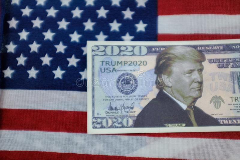 Harrisburg, PA - September 26, 2019 : Donald Trump 2020 Re-Election Presidential Dollar Bill against a United States of America. Flag royalty free stock photography
