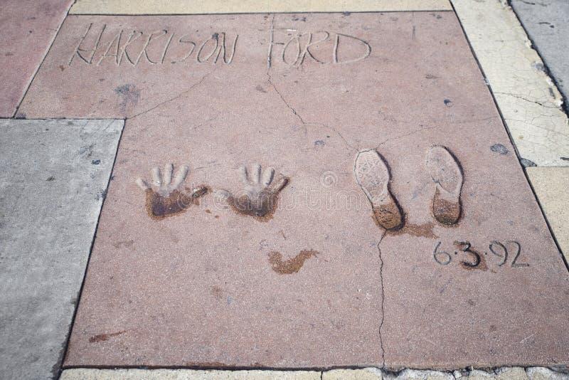 Harrison Ford handprints-fotspår i Hollywood arkivfoto