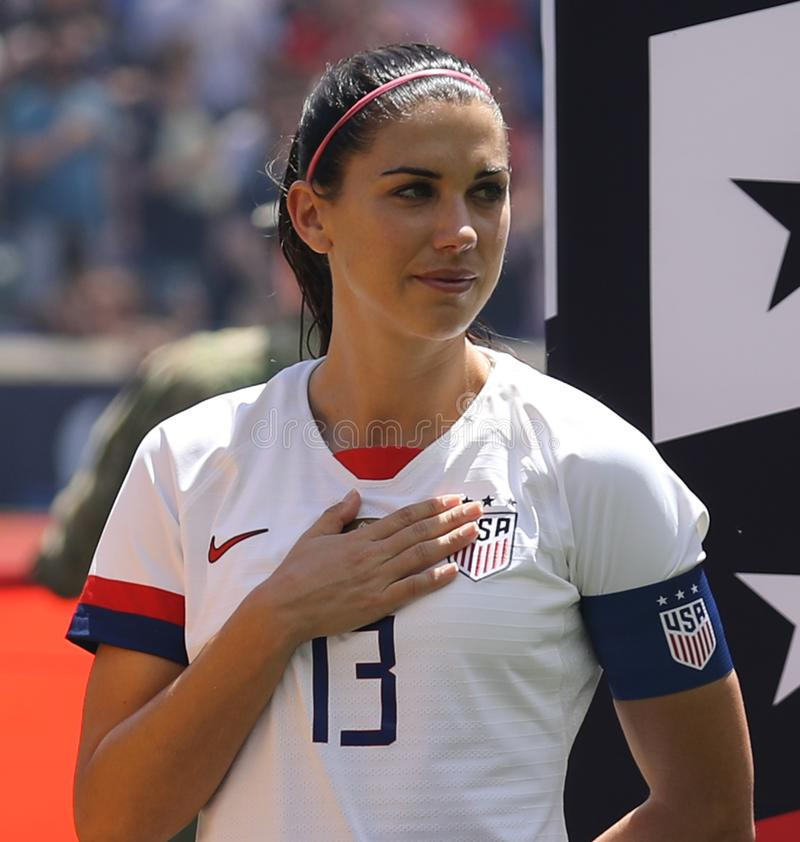 U.S. Women`s National Soccer Team captain Alex Morgan #13 during National Anthem before friendly game against Mexico. HARRISON, NJ - MAY 26, 2019: U.S. Women`s royalty free stock photography