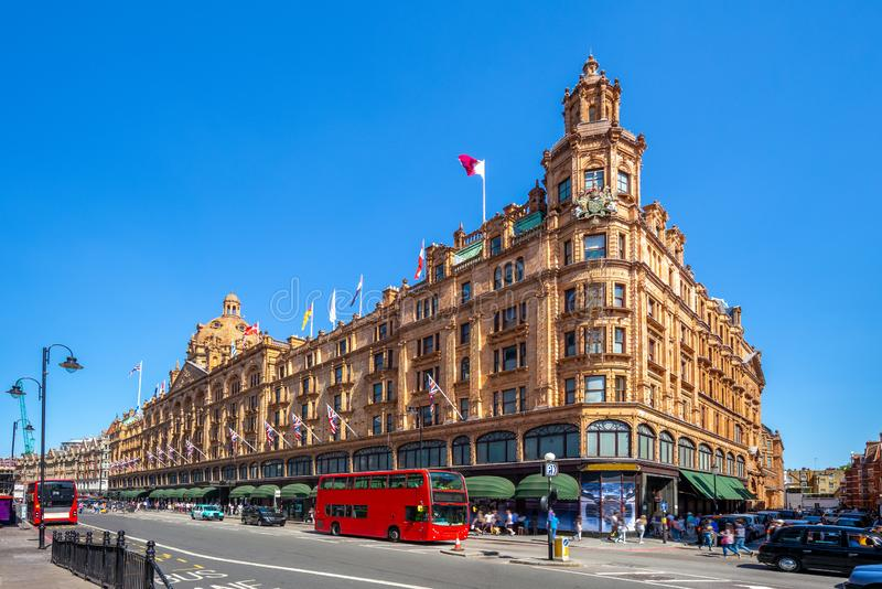 Street view of london with famous department stores. Harrods, the world`s most famous department store online with the latest men`s and women`s designer fashion stock images