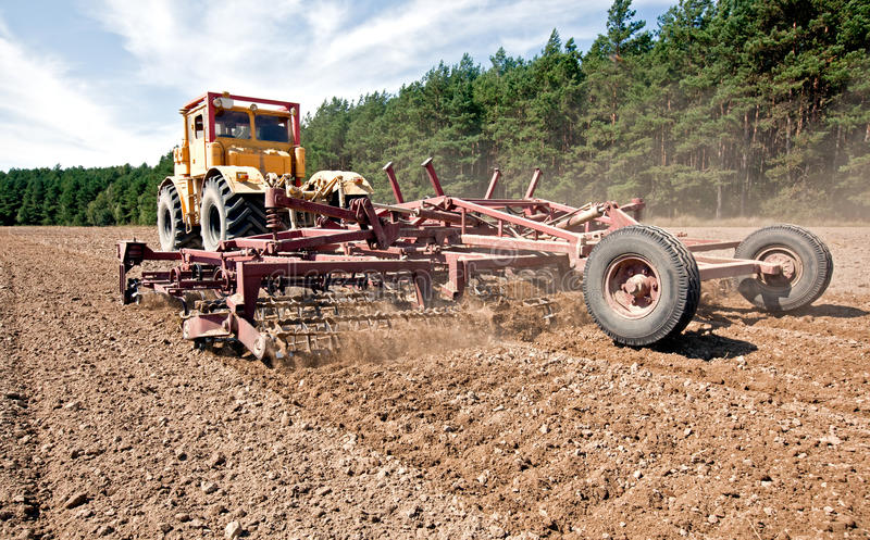 Download Harrowing a field stock photo. Image of part, agricultural - 21007158