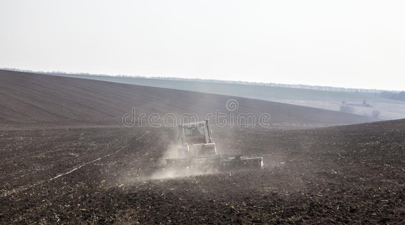 Harrowing the soil with disc harrows. In spring in Ukraine stock photography