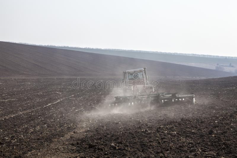 Harrowing the soil with disc harrows. In spring in Ukraine stock image
