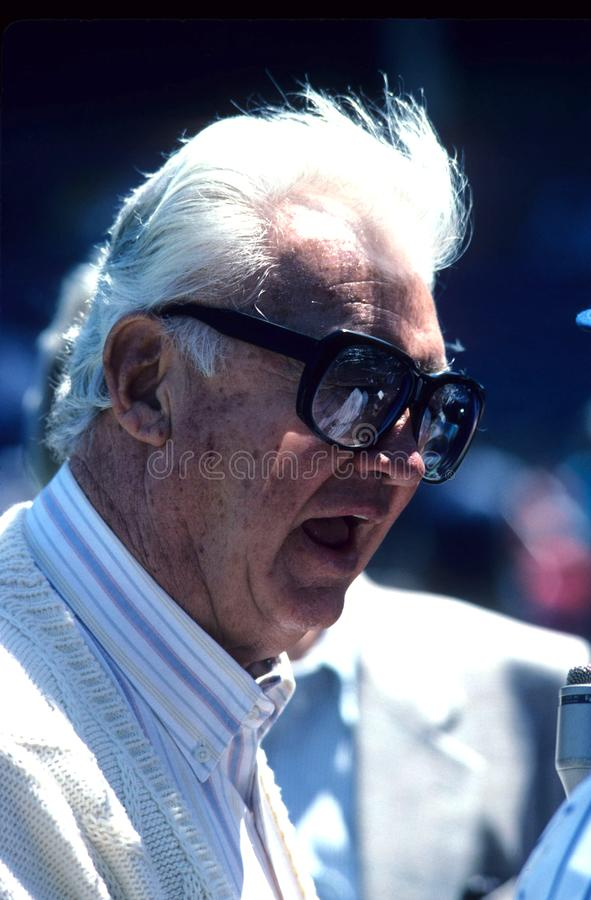 Harry Carey Chicago Cubs. Sports broadcaster talking to fans before the start the a baseball game stock images