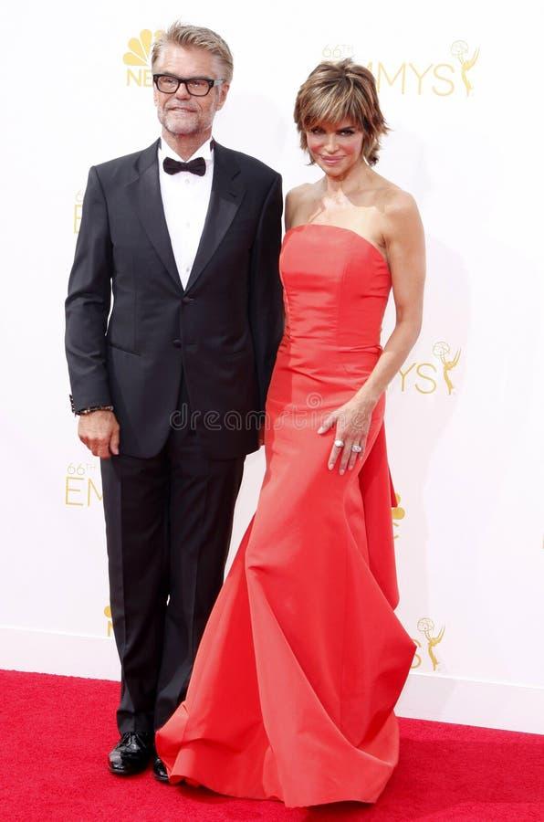 Harry Hamlin en Lisa Rinna stock foto's