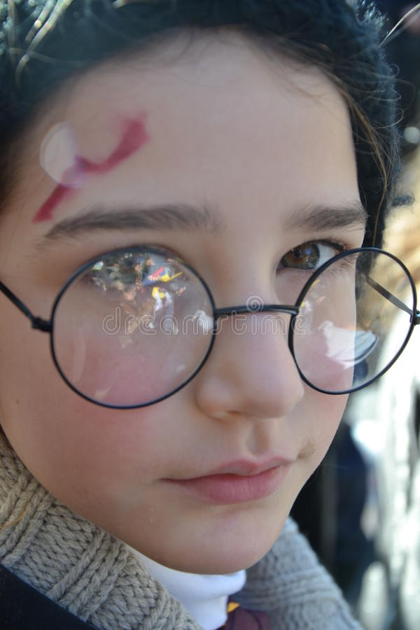 Harry Potter lookalike - carnival. Carnival, child dressed as Harry Potter character Event: carnival Grande Sfilata del Carnevale Monfalconese date: February royalty free stock image