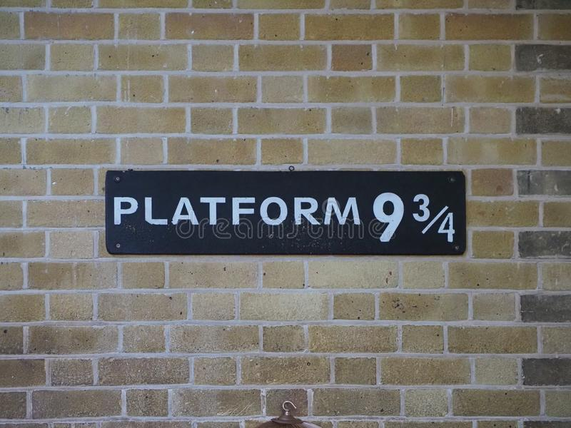 Harry Potter Platform Nine and Three Quarters in London. LONDON, UK - CIRCA SEPTEMBER 2019: Harry Potter Platform Nine and Three Quarters at King's Cross Station stock images