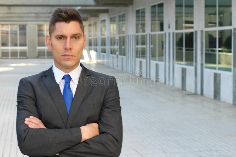 Harsh businessman looking defensive and cruel.  royalty free stock photography
