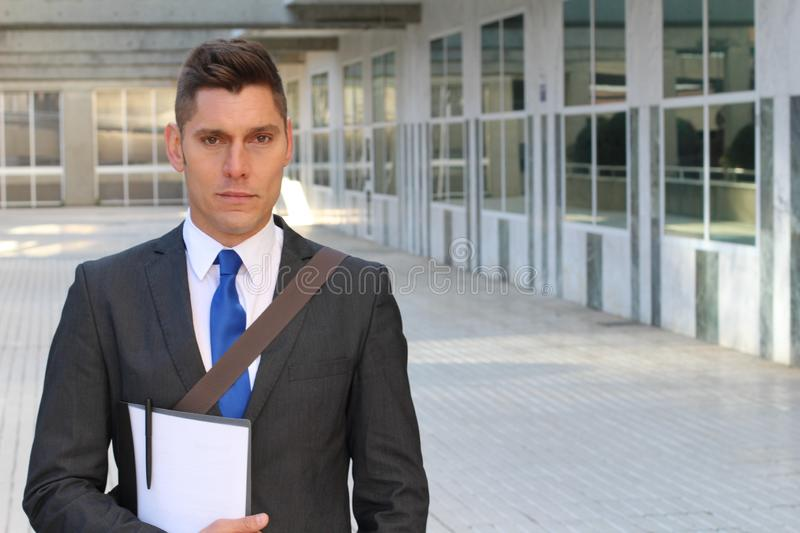 Harsh looking businessman wearing suit and tie royalty free stock photo