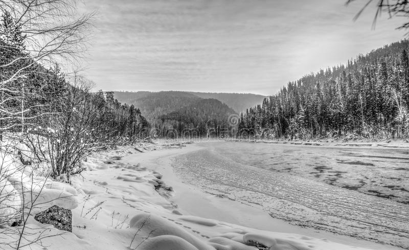The river before the ice. The harsh Siberian nature black and white photo of the river before the ice royalty free stock images
