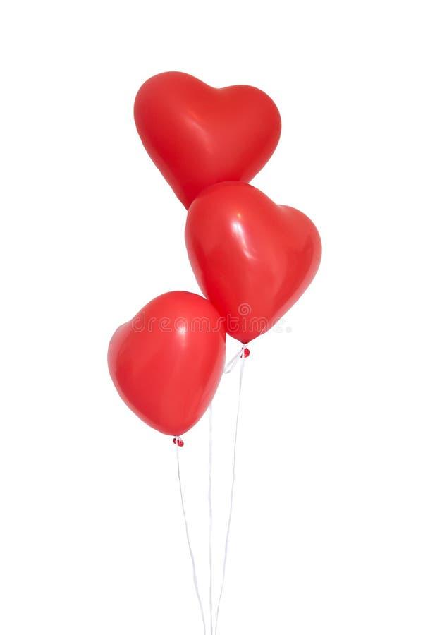 Hart drie vormde rode ballons op witte achtergrond stock afbeeldingen