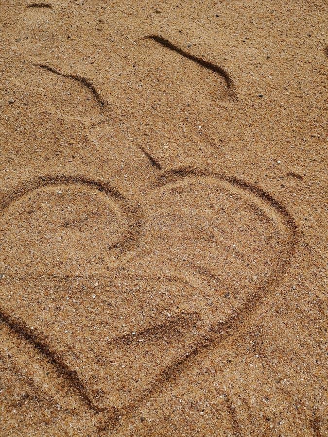 Hart in het zand royalty-vrije stock afbeelding