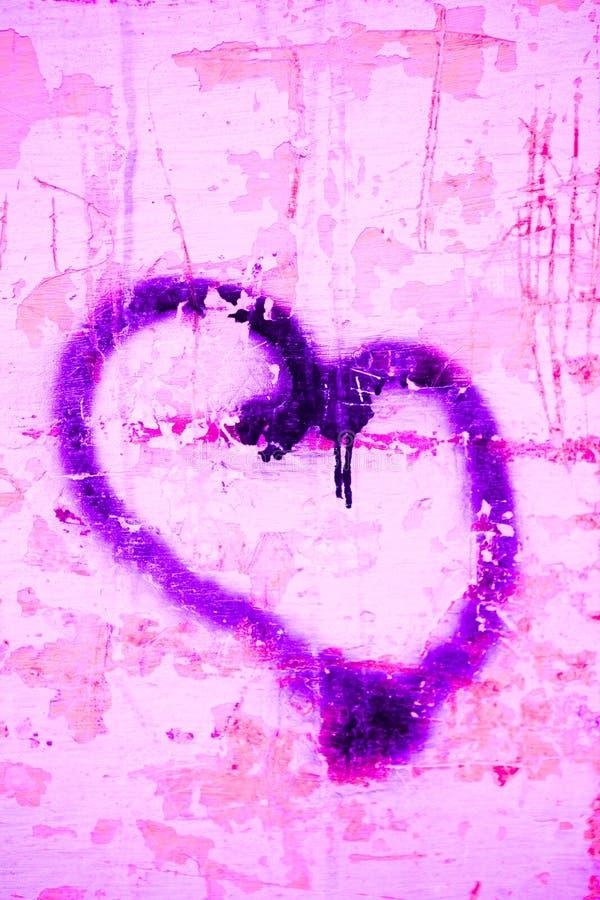 Hart op een muur stock afbeeldingen