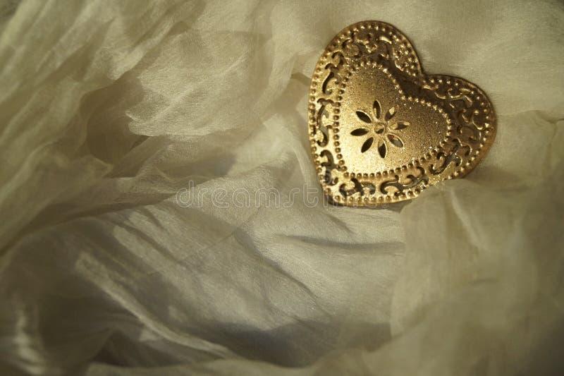 Hart van gouden metaal stock fotografie