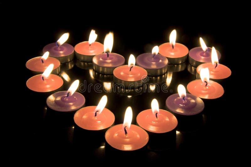 Hart van kaarsen stock foto
